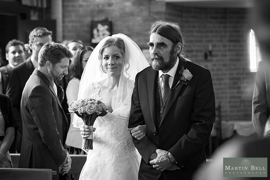 Rhinefield House wedding photography by Martin Bell Photography - Bride walking down the Aisle