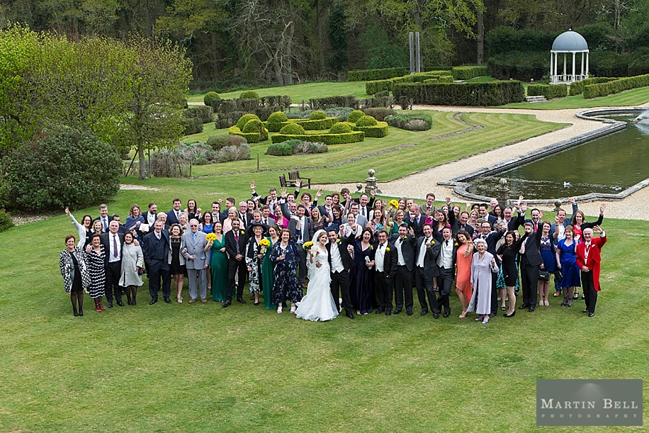 Big group photograph of all guests at the Rhinefield House wedding