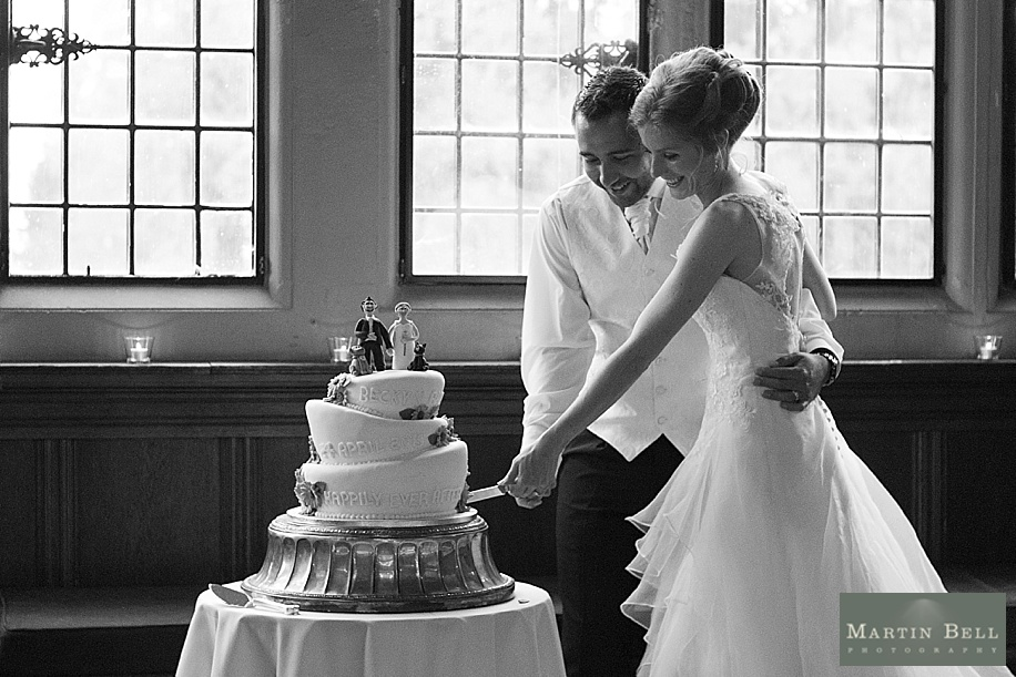 Bride and Groom cutting the cake at a Rhinefield House wedding
