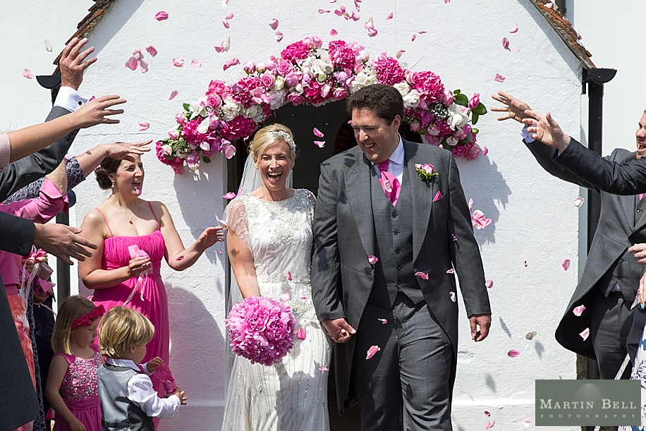 Wedding photographs at All Saints, Chalbury - Dorset wedding photographers - Martin Bell Photography - confetti photograph