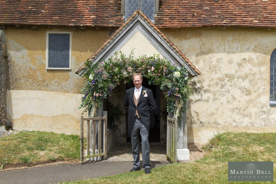 Groom portrait at a church - Hampshire wedding photographer - Martin Bell Photography