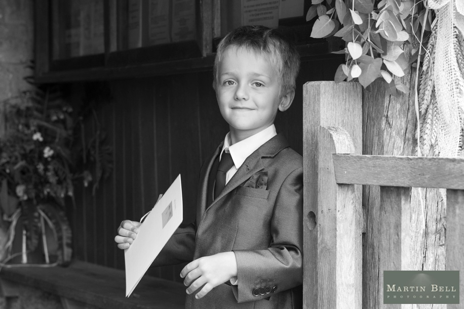 Pageboy portrait at a church in Winchester - Hampshire wedding photographer - Martin Bell Photography
