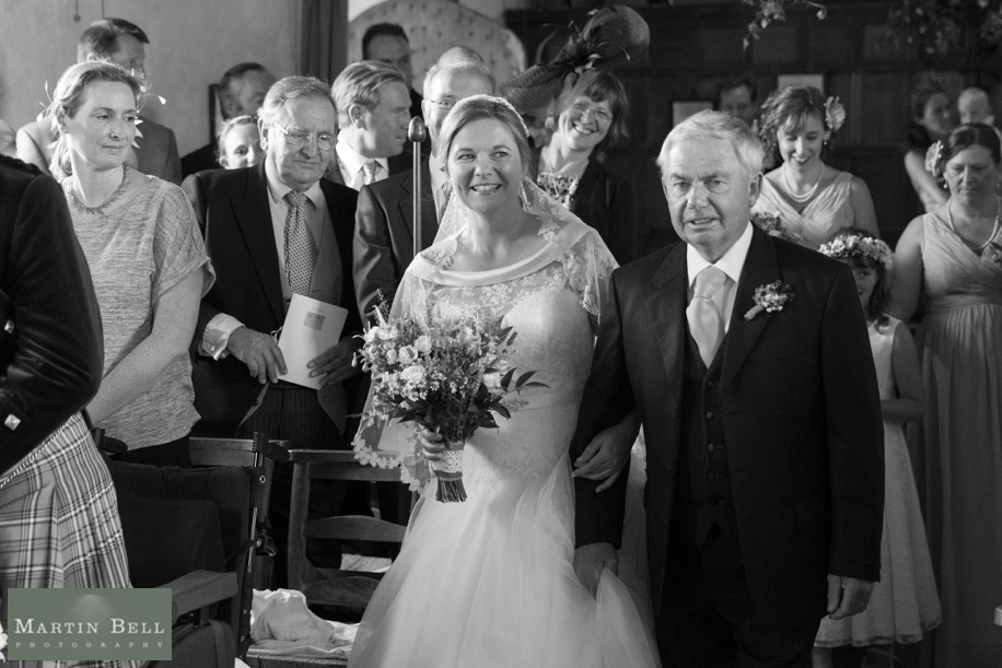 Bride walking down the aisle  - marquee wedding Winchester - Martin Bell Photography