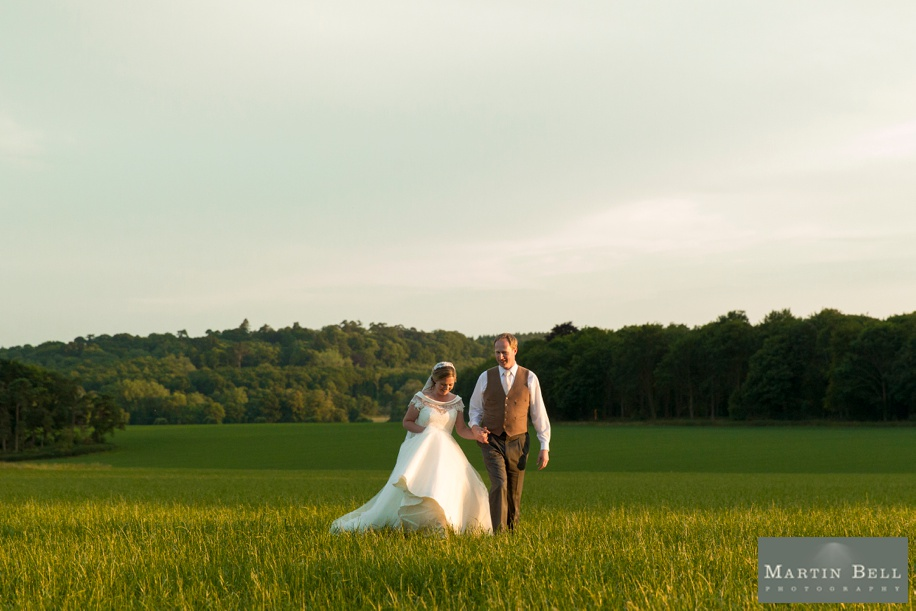 Marquee wedding - Bride and Groom photographs at Sunset in Winchester