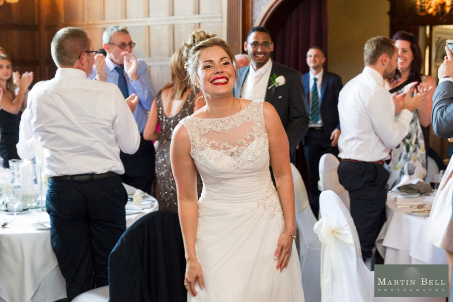 Bride and Groom entering wedding breakfast at Rhinefield House- Martin Bell Photography