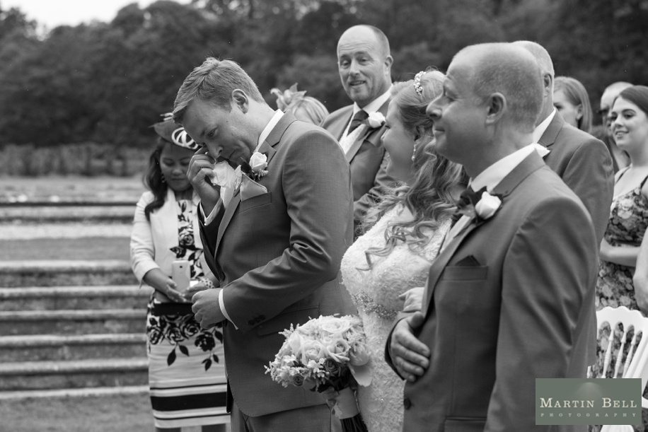 Groom's reaction to seeing his Bride for the first time at a Rhinefield House wedding in the outdoor ceremony area