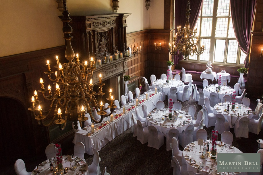 Rhinefield House Grand Hall on a wedding day with a pink colour scheme