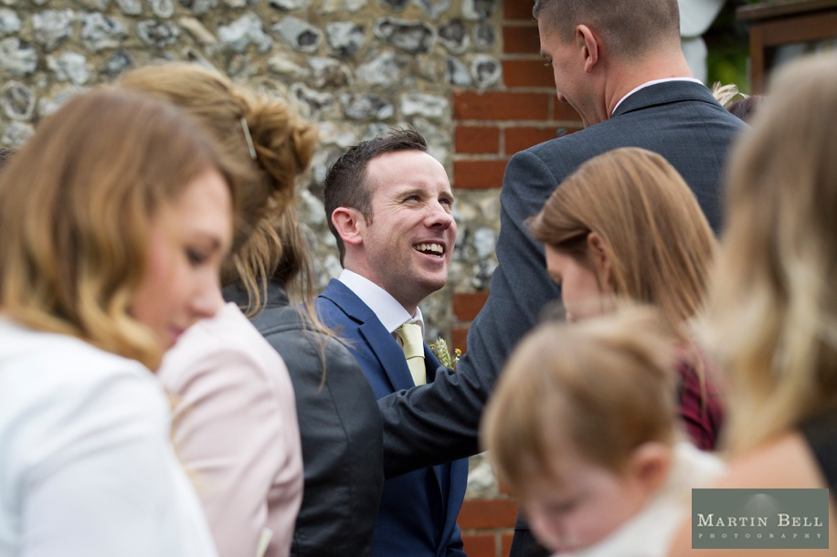 Happy Groom at his wedding at St Andrew's Church in Owslebury