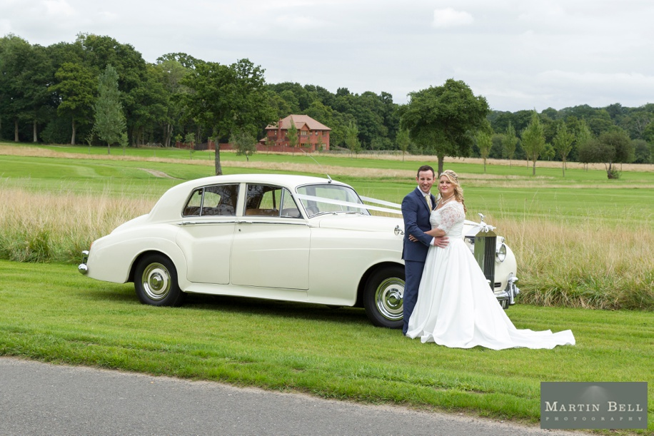 Happy Bride and Groom with their vintage Rolls Royce at a East Horton Golf Club wedding