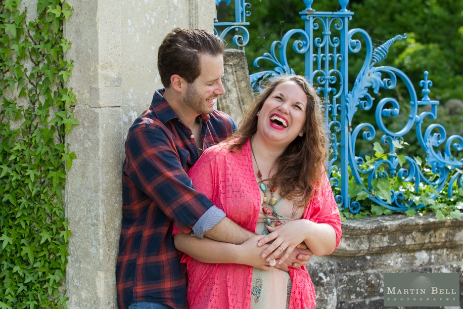 Happy couple during an engagement photo shoot in Hampshire