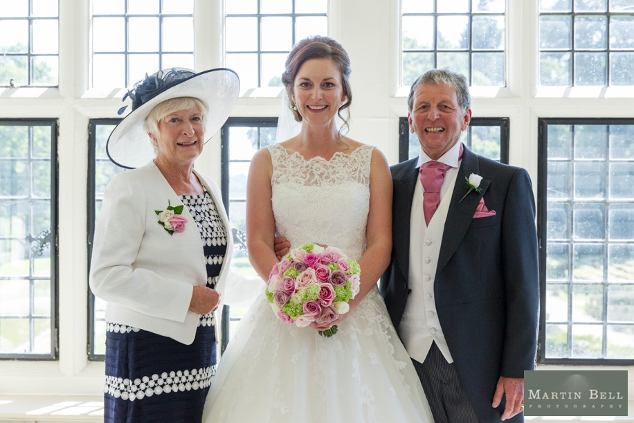 photograph of Bride with her parents at a Rhinefield House wedding