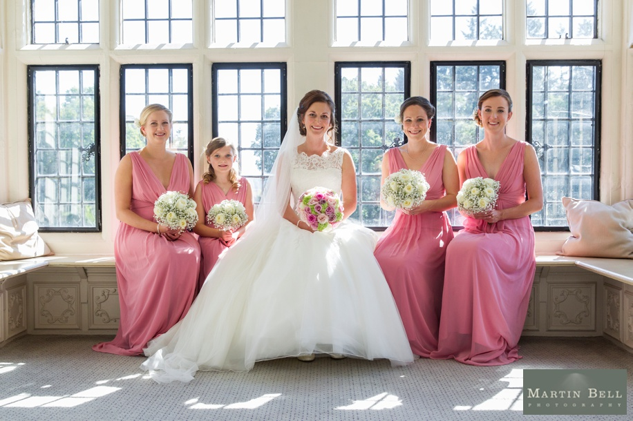 Bride with her Bridesmaids in the Walker Suite at a Rhinefield House wedding