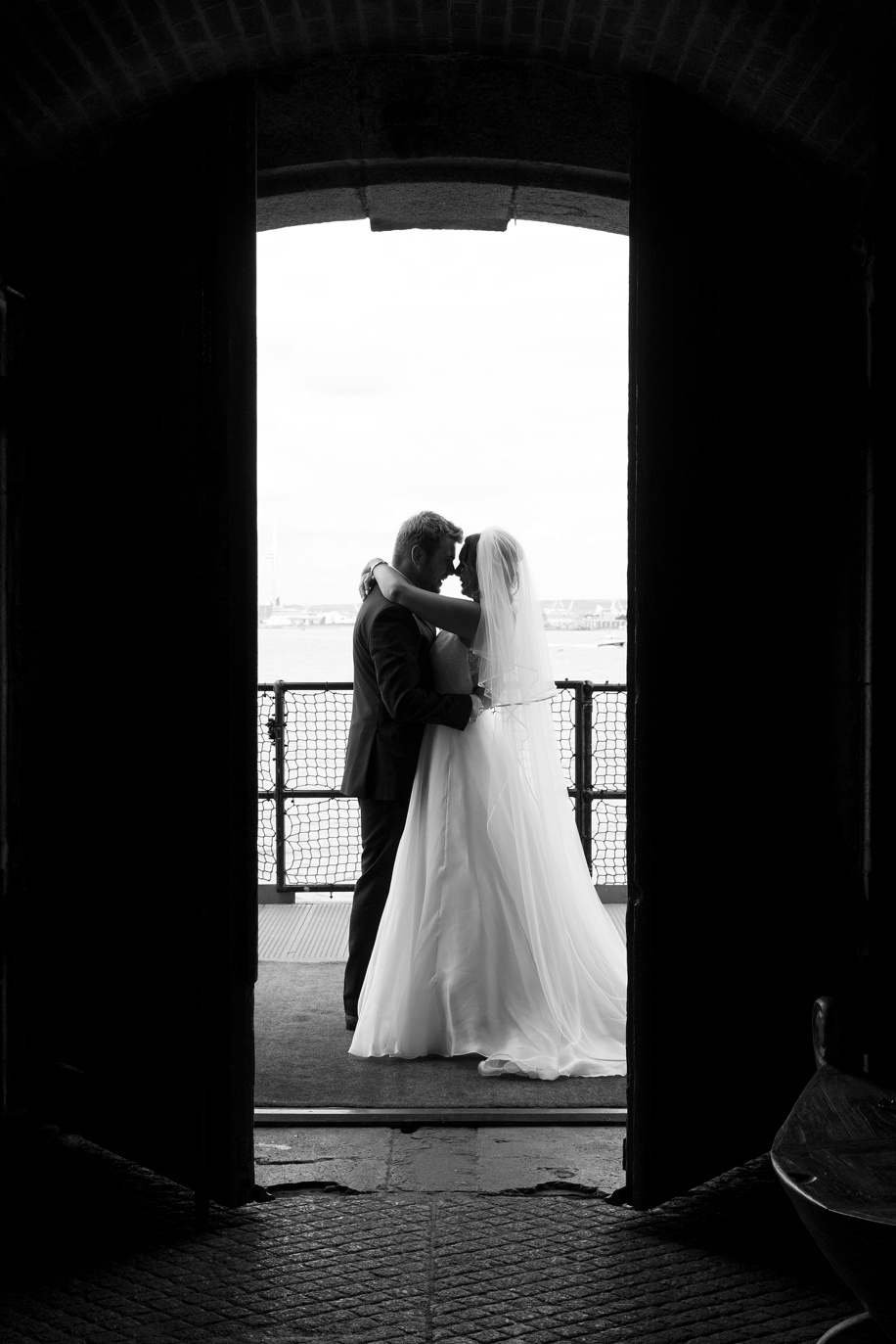 Spitbank Fort wedding photography - Bride and Groom by entrance - Martin Bell Photography