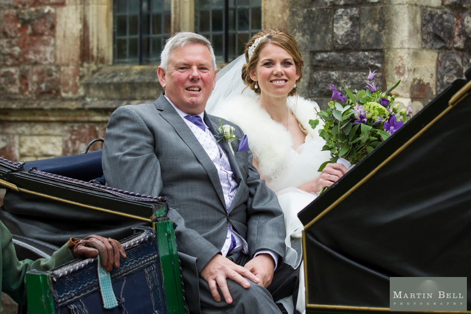 Wedding photographer Hampshire - St Thomas All Saints Church, Lyminton wedding - Bride arriving in a Horse and Carriage