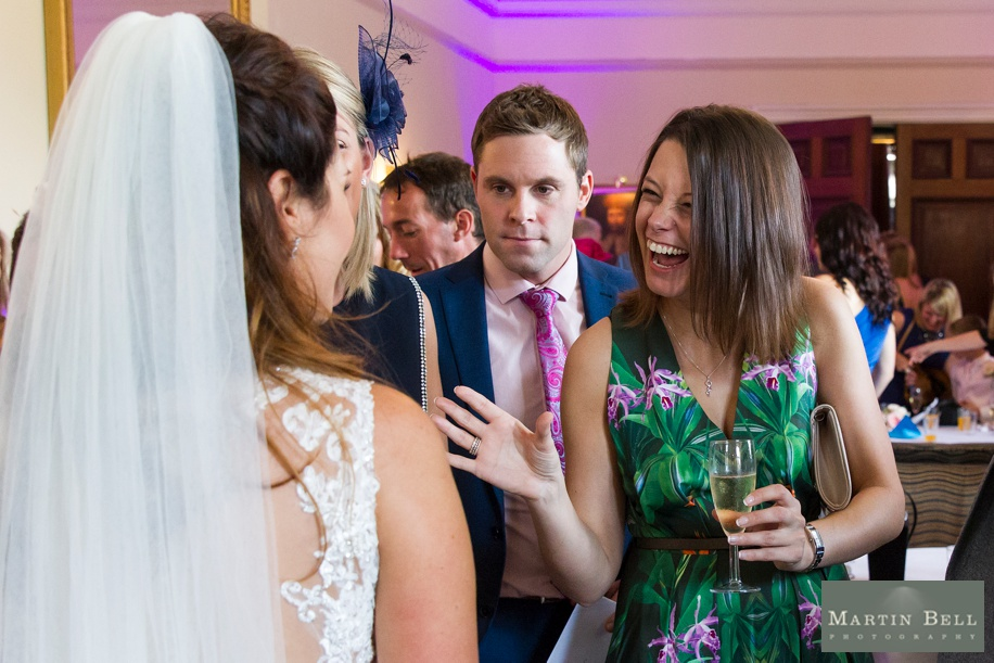 Documentary wedding photography at Rhinefield House wedding - Drinks reception