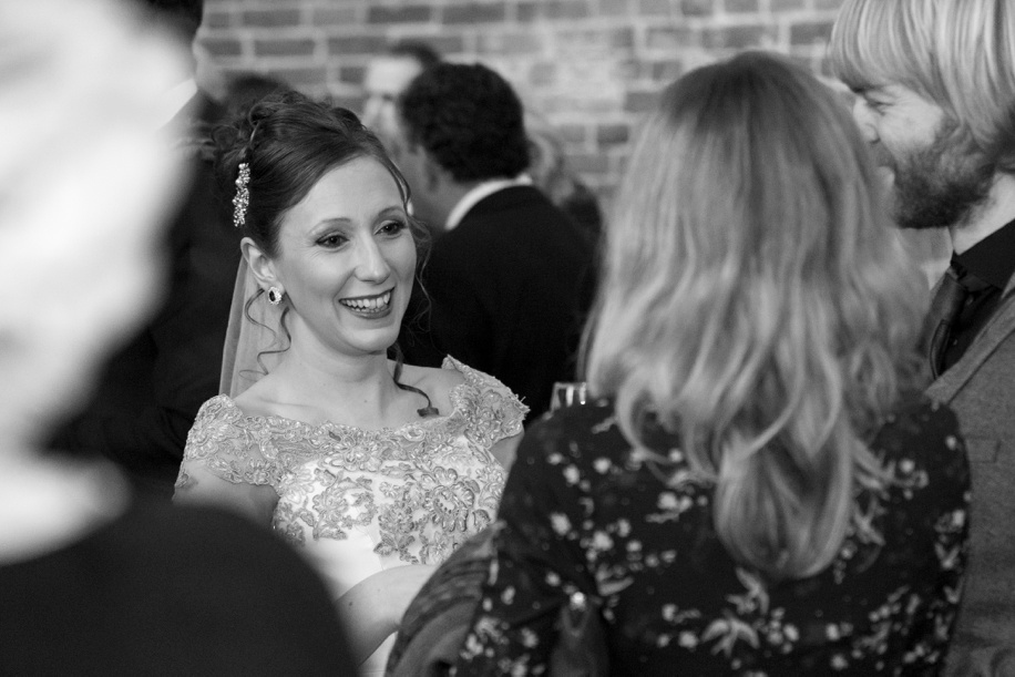 A happy Bride during her drinks receptions at a Highcliffe Castle wedding
