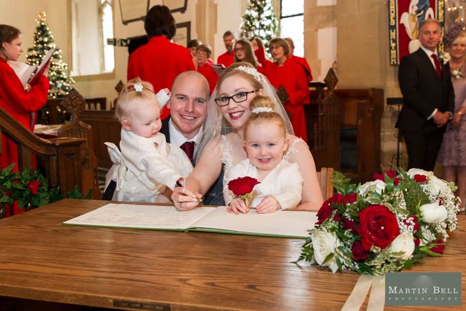 Hampshire documentary wedding photography at St Peters Church in Bishops Waltham - Bride and Groom signing the register