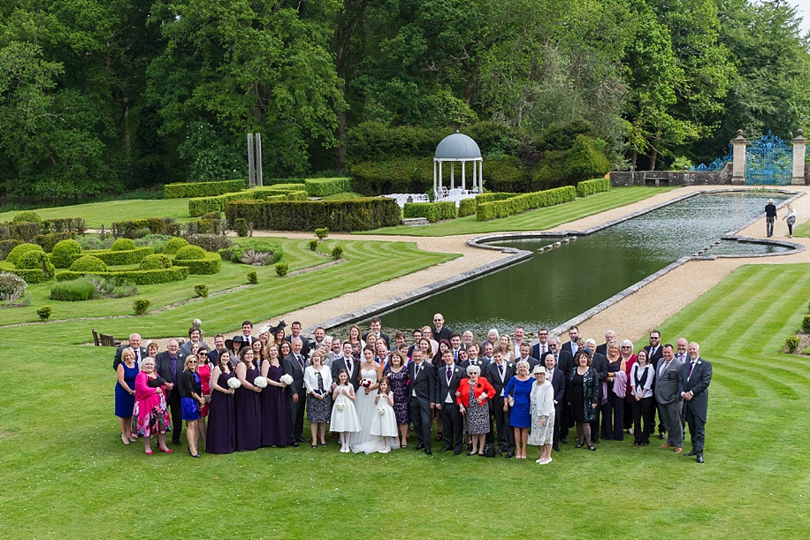 Big group wedding photograph at Rhinefield House in the New Forest