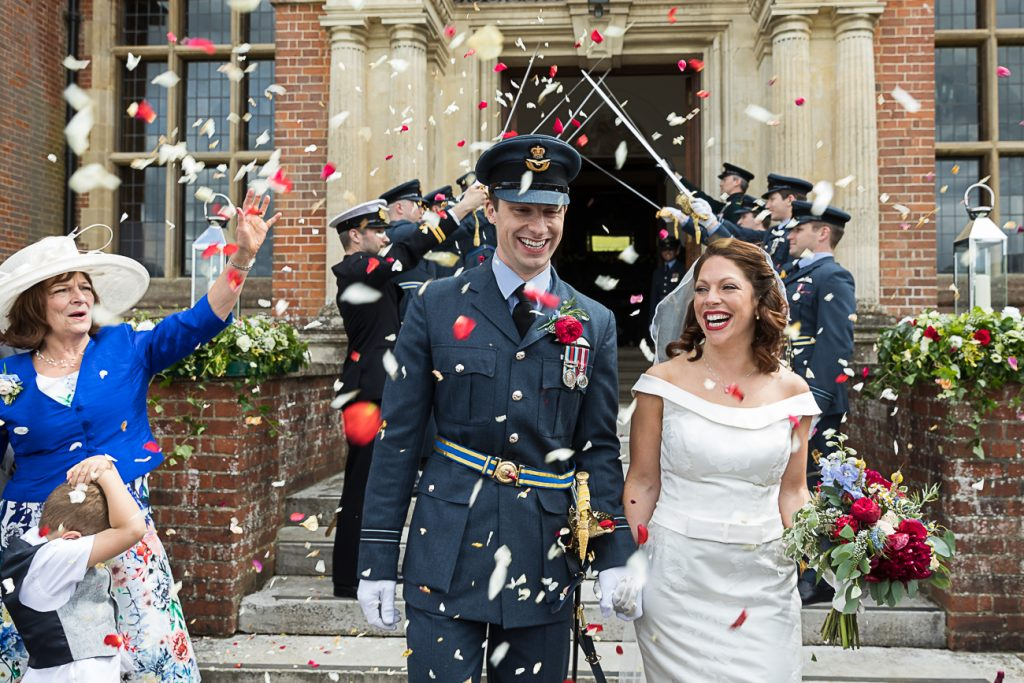 Happy Bride and Groom after their military sword procession