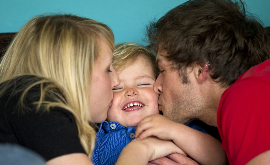 Family photographer in Fareham, Hampshire with a family of three