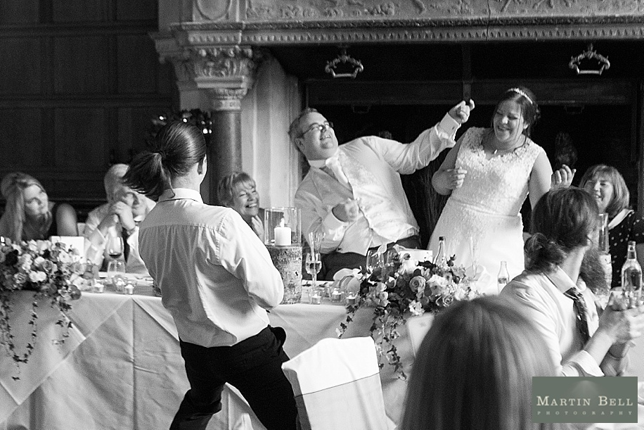 A Rhinefield House wedding by Hampshire wedding photographer - Martin Bell Photography - singing waiters