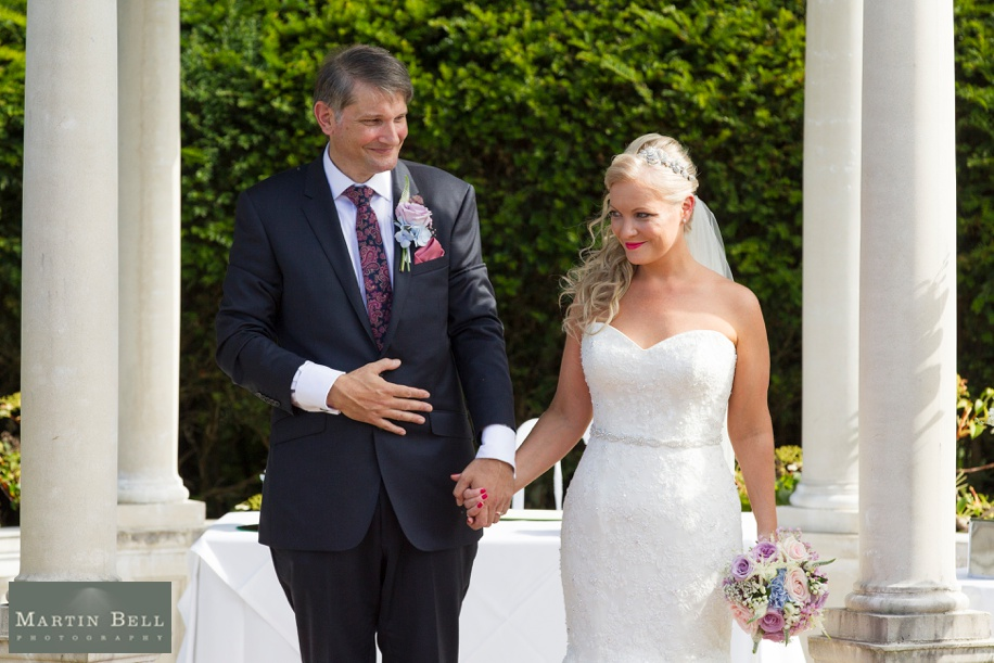 Happy Bride and Groom during a small outdoor Rhinefield House wedding