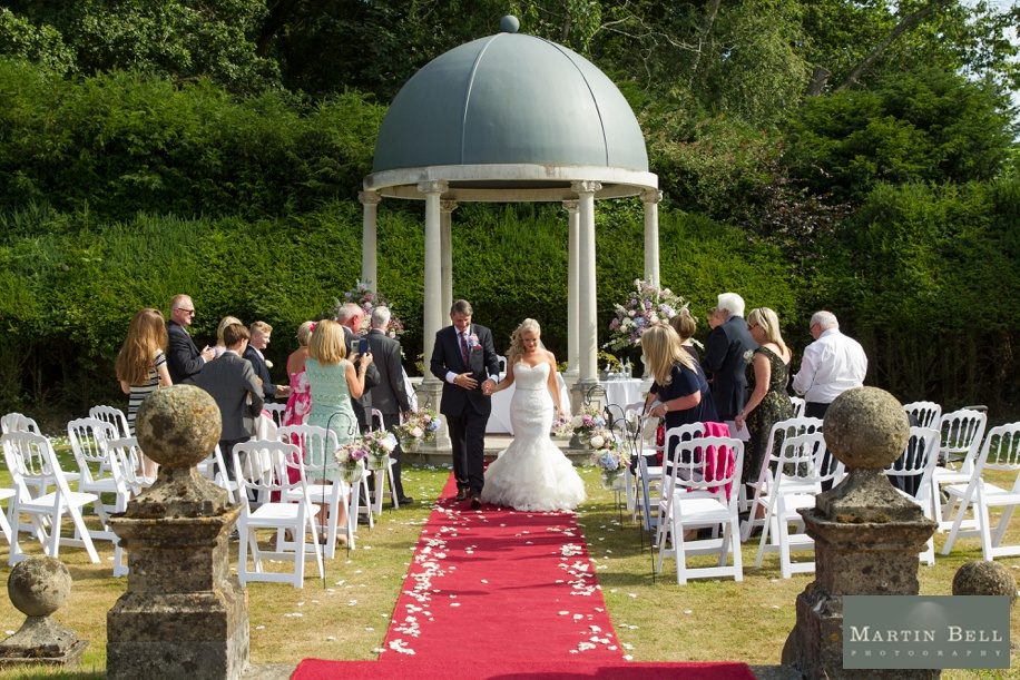 Happy Bride and Groom walking up the aisle during a small outdoor Rhinefield House wedding