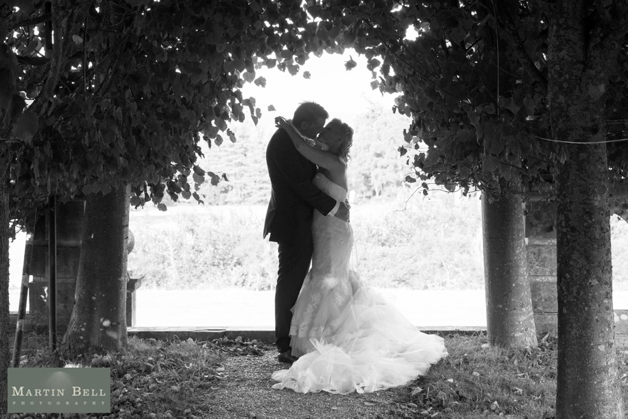 Bride and Groom photograph in the Walker Suite during an intimate Rhinefield House wedding
