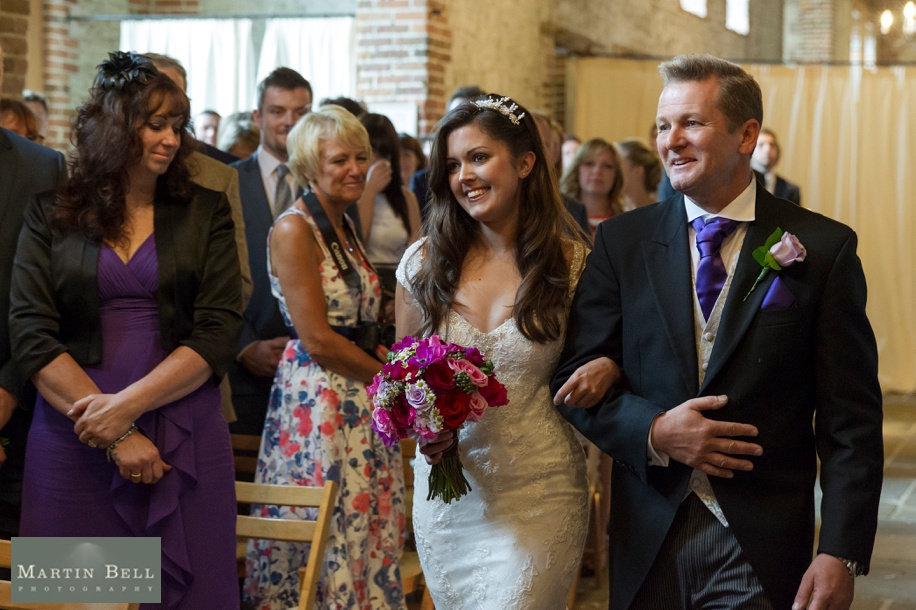 Manor Barn Buriton wedding photography - Brides and dad walking down the aisle