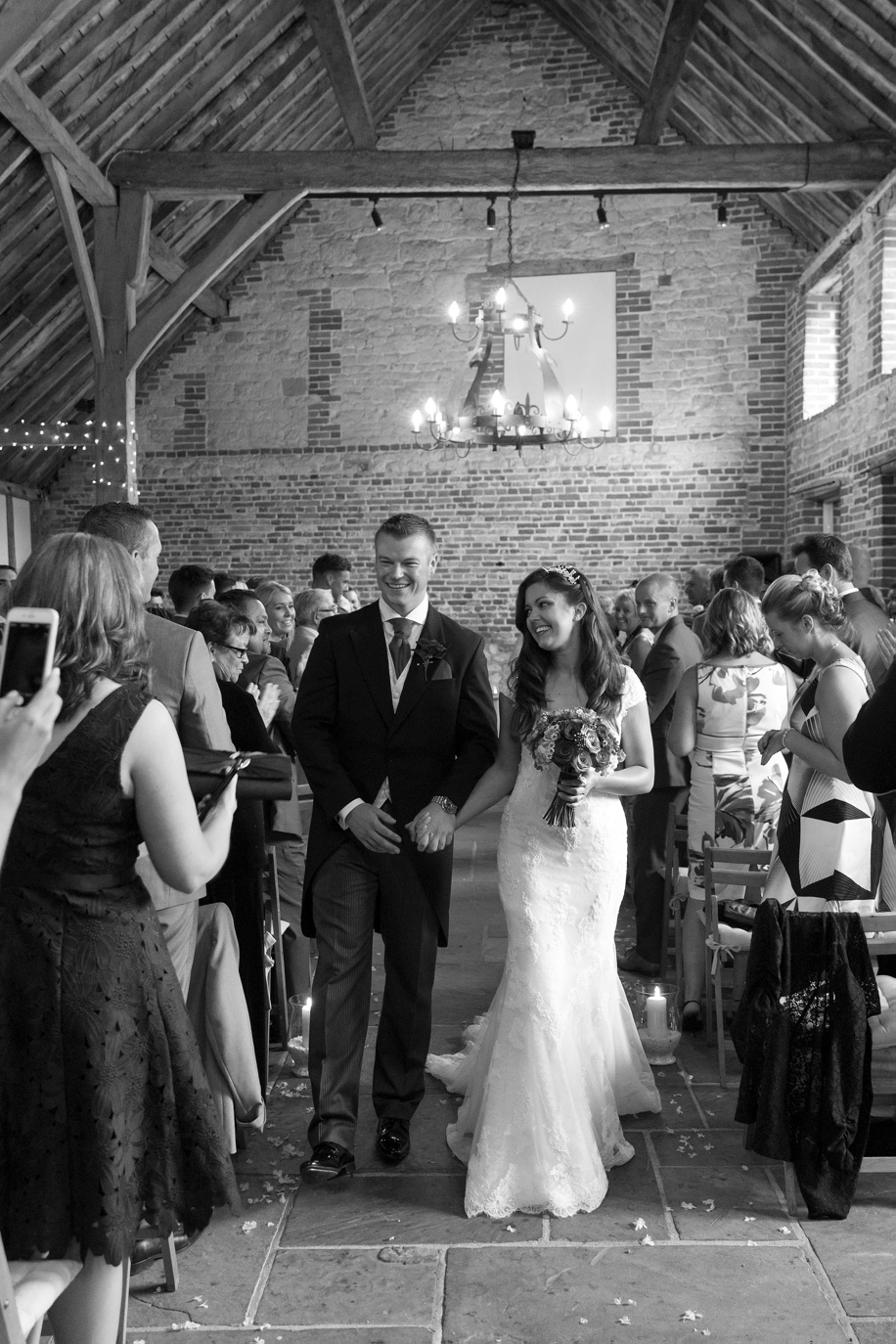 Bride and Groom walking up the aisle together