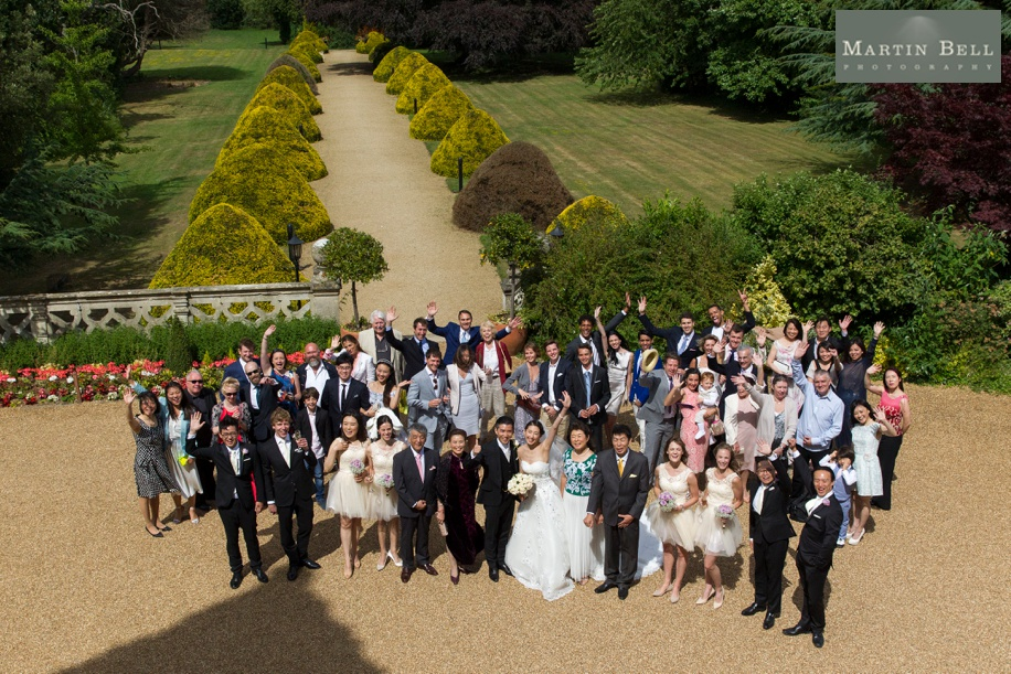 Big group photo of all guests - Manor by the Lake wedding - Martin Bell Photography