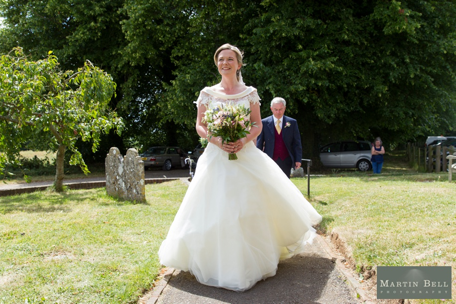 Bride walking into church - marquee wedding Winchester - Martin Bell Photography