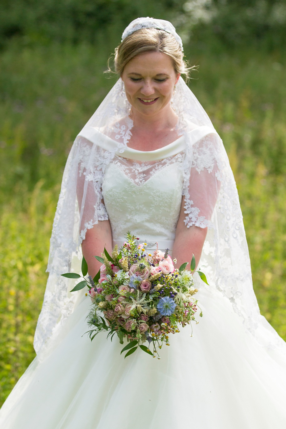 Bride portrait photograph ideas at a Winchester marquee wedding in Hampshire by Martin Bell Photography