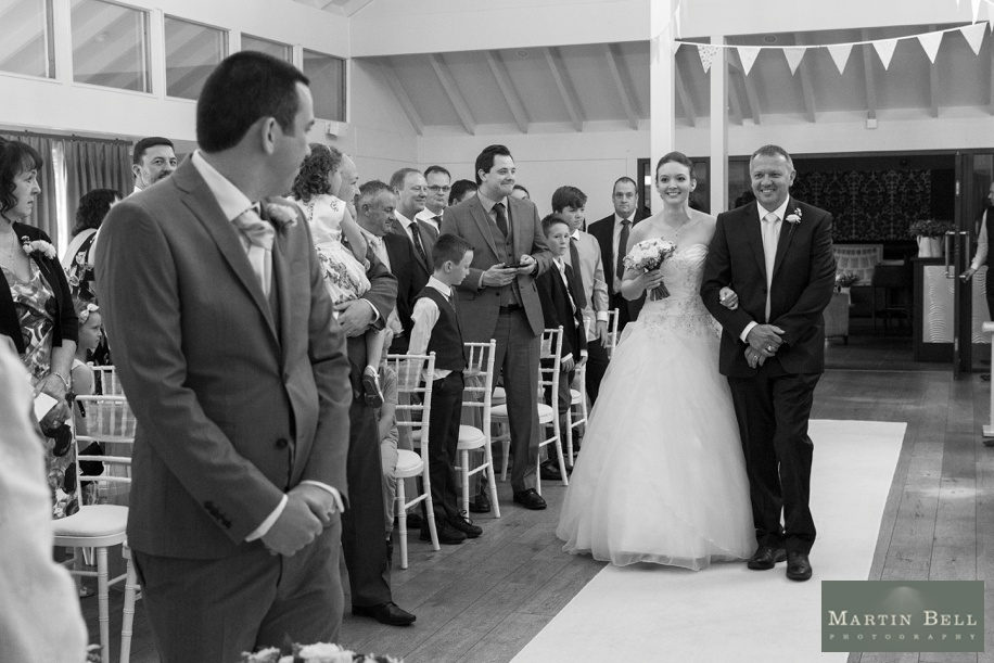 Documentary wedding photography at Marwell Hotel - Bride's entrance