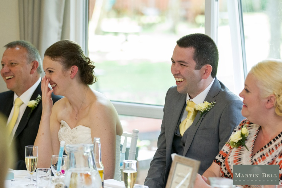 Happy Bride and Groom at a Marwell Hotel wedding during the best man's speech