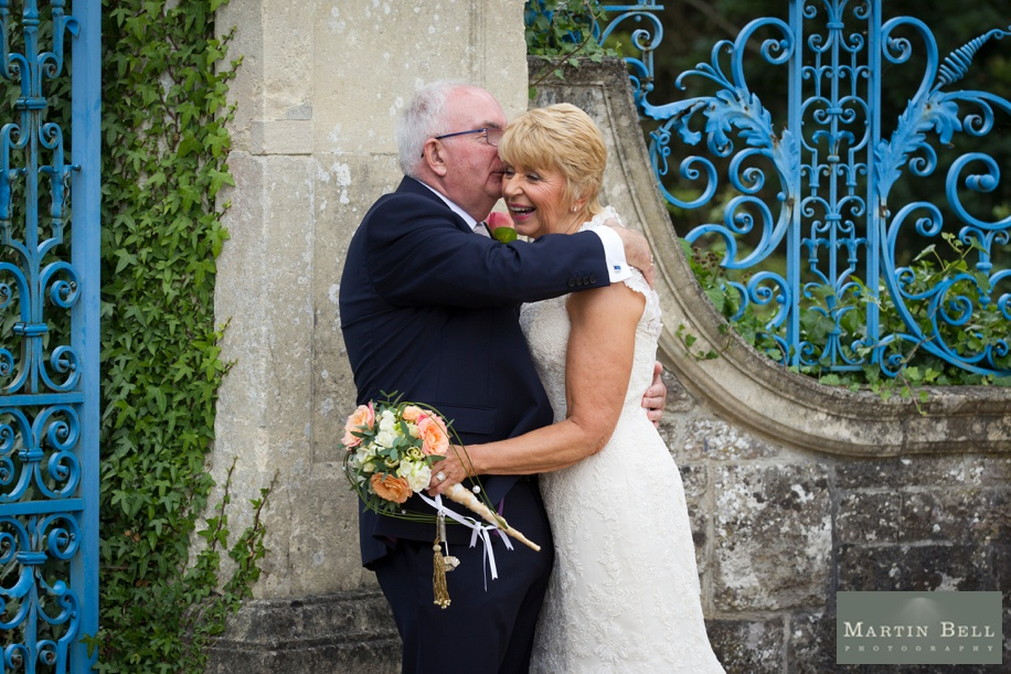 Rhinefield House wedding photography at the blue gates during Anne and David's New Forest wedding - Martin Bell Photography