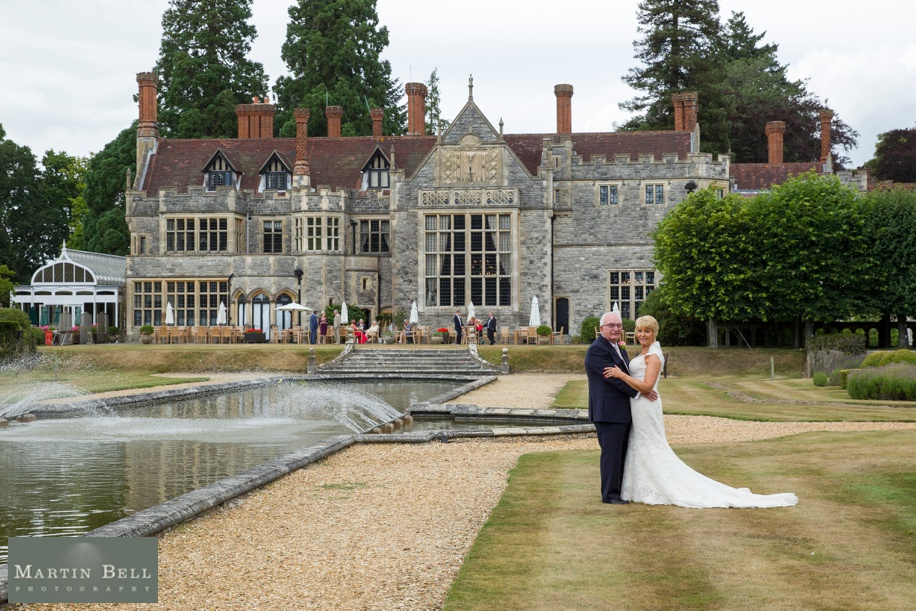 Bride and Groom in front of Rhinefield House