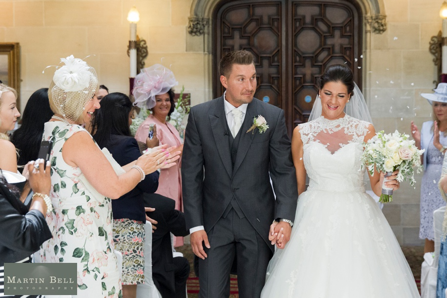 Northcote House wedding photography - Bride and Groom leaving wedding ceremony