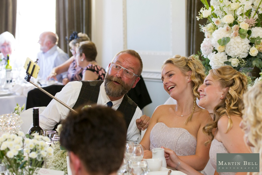 Documentary wedding photography at Northcote House - wedding favour ideas - selfie stick