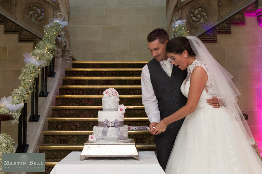 Bride and Groom cutting their wedding cake at Northcote House