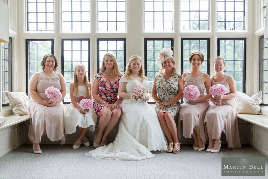 Bridal party photograph in Walker Suite at Rhinefield House