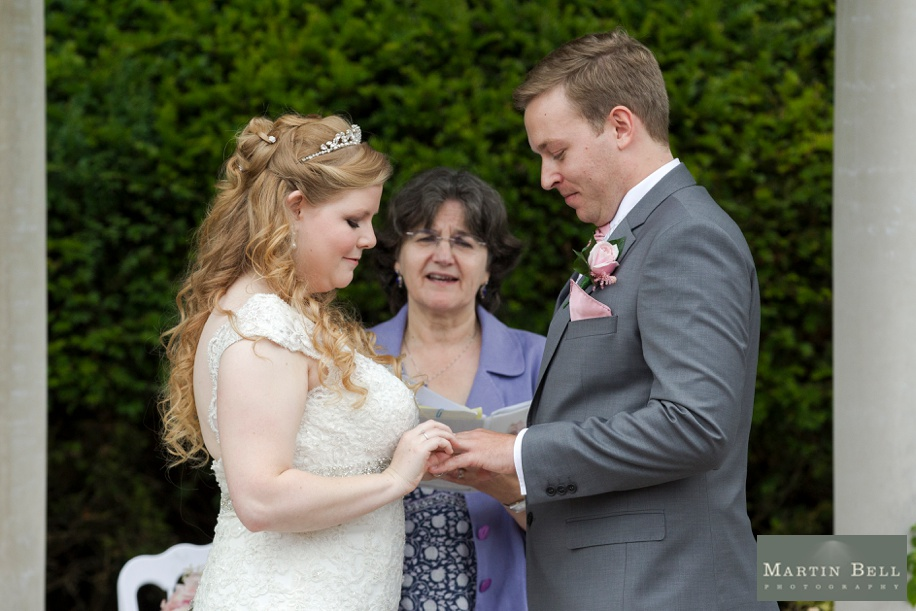 Bride and Groom saying their vows in the outdoor ceremony area at Rhinefield House