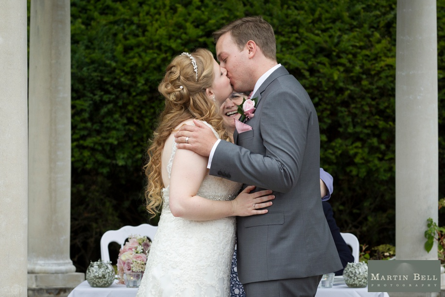 Bride and Groom's first kiss at  Rhinefield House