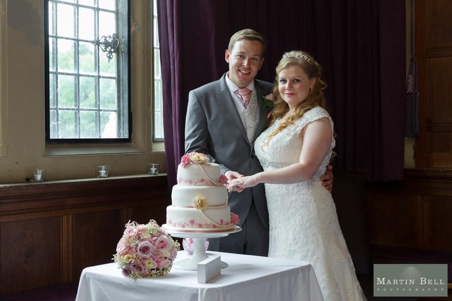 Rhine field House wedding - Bride and Groom cutting the cake