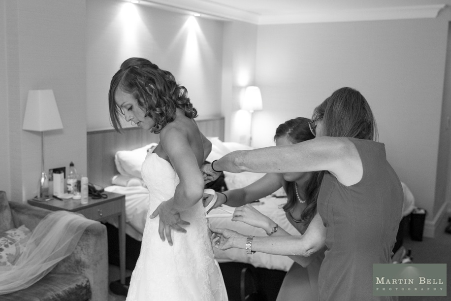 Documentary wedding photography - Bride getting into dress