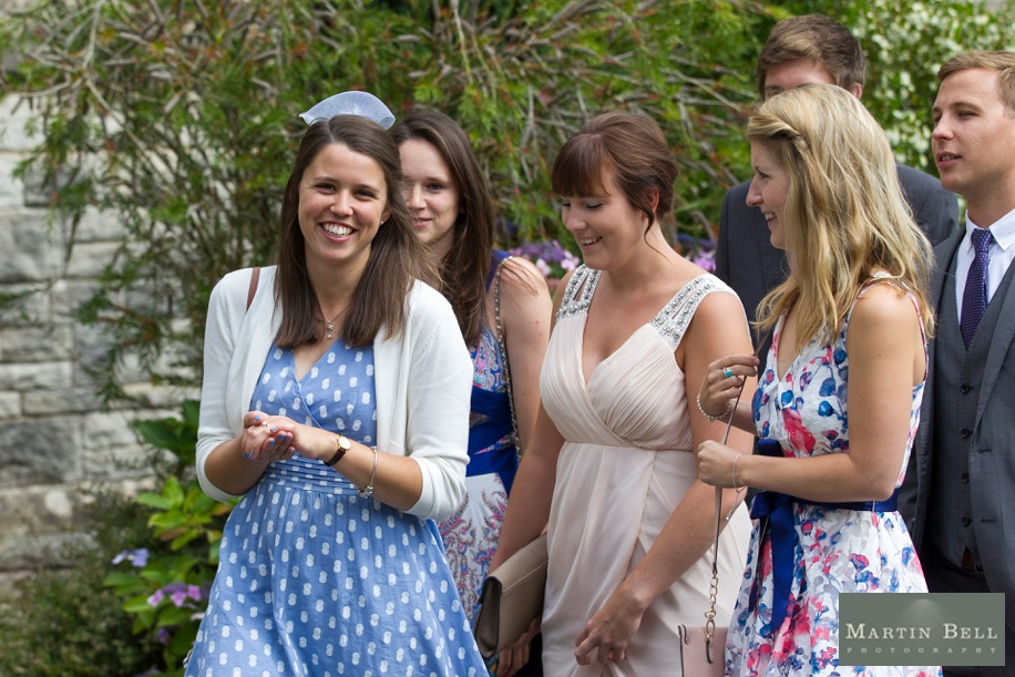 Guests arrive at a church wedding - Hampshire wedding photography