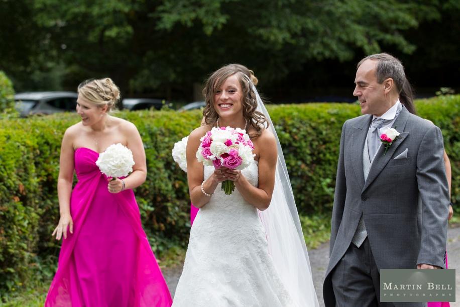 Excited Bride arriving at a St Nicholas church wedding in Brockenhurst