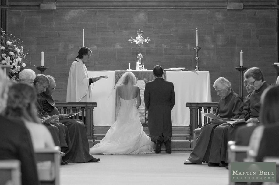 Wedding ceremony vows at St Nicholas church in Brockenhurst