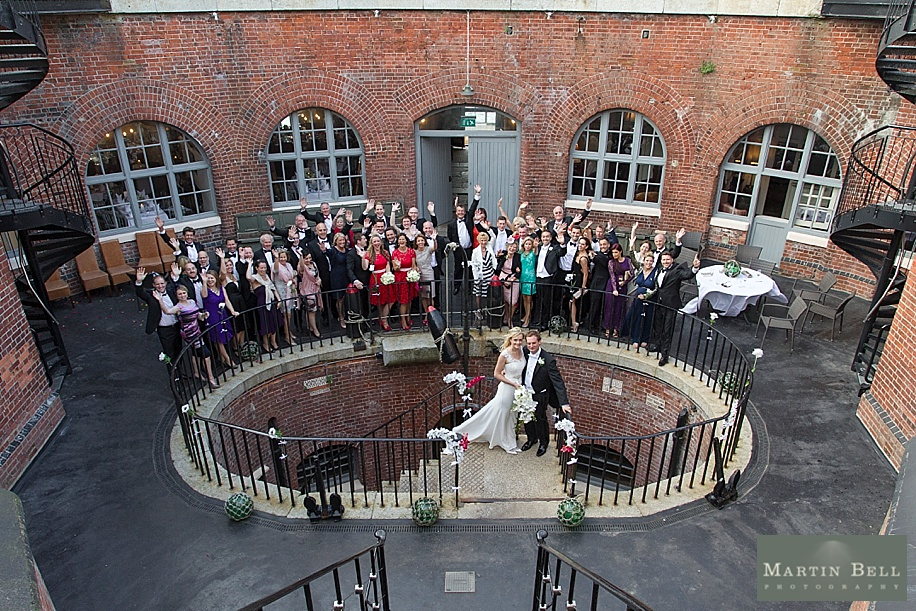 Chic and elegant Spitbank Fort Wedding by Martin Bell Photography - Group photograph of all guests