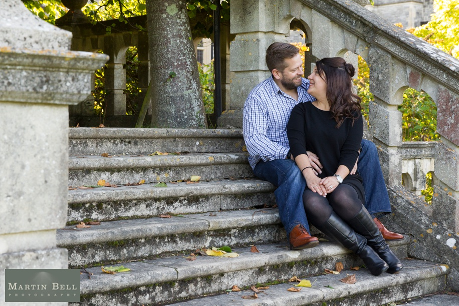 Happy couple during an engagement photo shoot at Rhinefield House in the New Forest